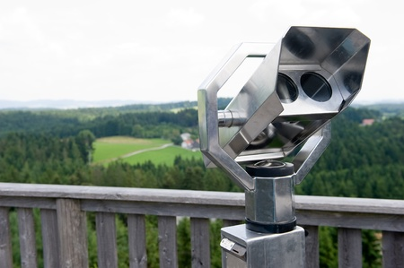 A binocular on a view point on a hill in the south of Germany