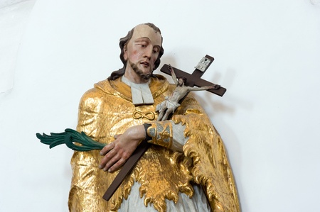 crucifiction: Wooden statue of a person who holds the cross with jesus in the church of Unter Griesbach in Germany Stock Photo