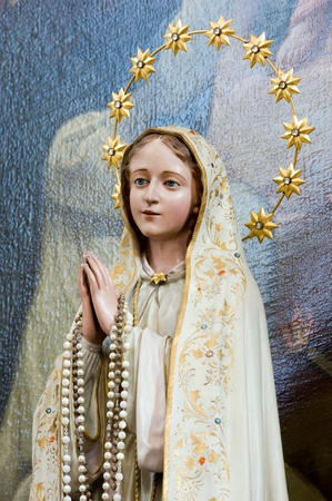 believing: Wooden statue of Maria in the church of Unter Griesbach in Southern Germany