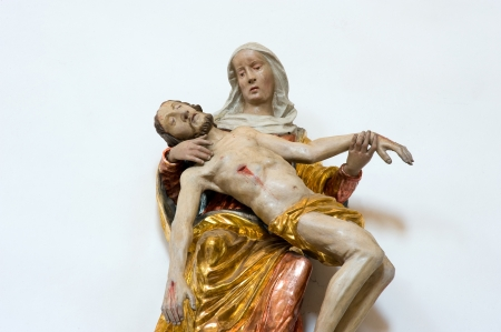 believing: Wooden statue of a woman who holds the dead body of jesus in the church of Unter Griesbach in southern Germany
