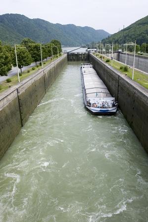 sluice: A ship in the sluice of Jochenstein in the Donau river
