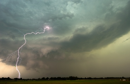 Thunder and lightning at the end of a hot and moistly day in the Netherlands photo