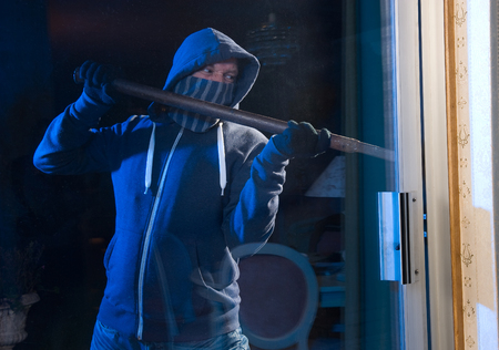 backdoor: A burglar trying to get into a house by the backdoor