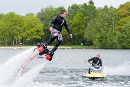 water skier: A man is giving a show how to keep in balance, and shows what you can do with the new sensation called flyboarding, May 12, 2013 in the Netherlands
