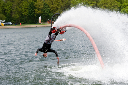 A man is giving a show how to keep in balance, and shows what you can do with the new sensation called flyboarding, May 12, 2013 in the Netherlands