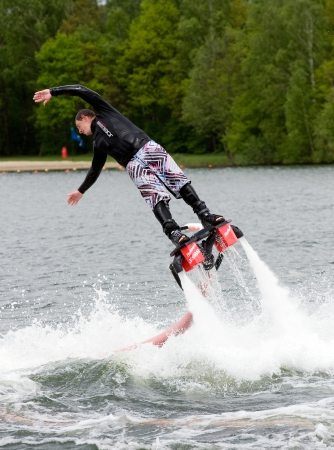 jet skier: A man is giving a show how to keep in balance, and shows what you can do with the new sensation called flyboarding, May 12, 2013 in the Netherlands