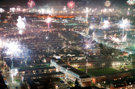 Fireworks on new years eve as seen from a 101 meters high building in the center of Enschede in the Netherlands photo