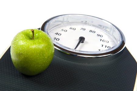 A weight scale with an apple photo