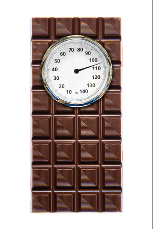 A piece of chocolate with a weight scale on it photo