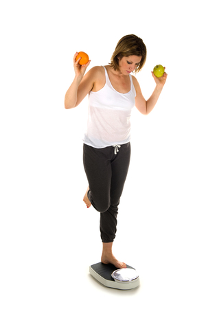 A woman standing on a weight scale with fruit