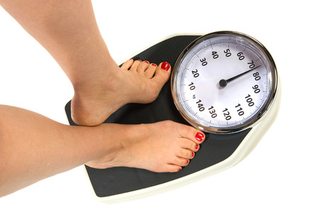 loose: A woman standing on a weight scale