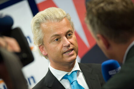 electing: ENSCHEDE, NETHERLANDS - SEP 05  Political leader Geert Wilders of the Dutch center right party PVV is giving a radio interview during campaigning, SEPTEMBER 05, 2012 in the Netherlands