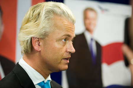 electing: ENSCHEDE, NETHERLANDS - SEP 05  Political leader Geert Wilders of the Dutch center right party PVV is listening during a radio interview, SEPTEMBER 05, 2012 in the Netherlands