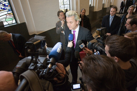 electing: ENSCHEDE, NETHERLANDS - Jan 25  Political leader Geert Wilders of the Dutch center right party PVV surrounded by press giving an interview, January 25, 2013 in the Netherlands Editorial