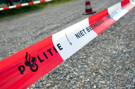 HAAKSBERGEN, NETHERLANDS - JUNE 09  Cordon tape from the dutch police is marking a crime scene and forbidden to pass, june 09, 2011 in the Netherlands Editorial