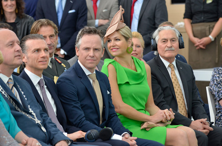 orange nassau: HAAKSBERGEN, NETHERLANDS - MAY 16  Queen Maxima of the Netherlands is looking backward during a speech just before she opened the new building of factory UNIPRO which is making glu for floors, May 16, 2014 in the Netherlands Editorial
