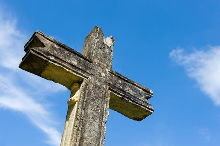 crucifiction: An old cross made of stone in the ancient city of Domme in France