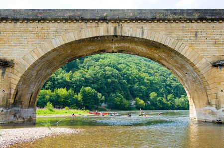 Arch of the bridge of Grolejac over the river Dordogne in France photo