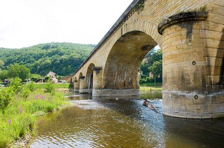 The bridge of Grolejac over the river Dordogne in France photo