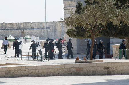 israelis: JERUSALEM, ISRAEL - OCT 08: Israeli police officers in front of the Al-aqsa mosque on the temple-square in Jerusalem after religious fightings with muslims, October 08 in Israel Editorial