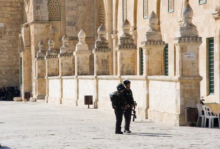 middle east fighting: JERUSALEM, ISRAEL - OCT 08: Israeli military security police on the eastern part of the Al-aqsa mosque on the temple-square in Jerusalem during fightings with muslims, October 08 in Israel Editorial