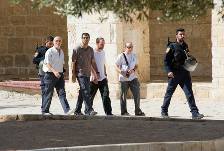 al aqsa: JERUSALEM, ISRAEL - OCT 08: Jews protected by security officers are walking on the temple-square and want to pray, this is the reason of the tensions and rioting with muslims , October 08 in Israel