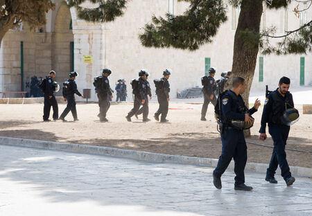 al aqsa: JERUSALEM, ISRAEL - OCT 08: Israeli police officers in front of the Al-aqsa mosque on the temple-square in Jerusalem after religious fightings with muslims, October 08 in Israel Editorial
