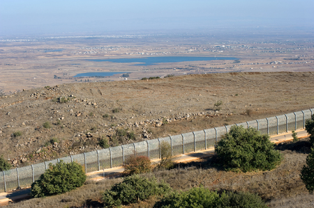syrian war: The fence of the border between Israel and Syria as seen from a hill on the Golan Heights about 10 kilometers southsouth-east of the city Al Quneitra