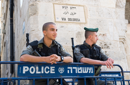 dolorosa: ISRAEL, JERUSALEM - OCTOBER 07, 2014: Two police officers are taking care of the security in the old city of Jerusalem on the via Dolorosa, the way Jesus walked with his cross