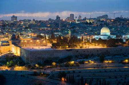 The dome of the rock and the al-aqsa mosque (left) on the temple mount in the twilight in Jerusalem photo