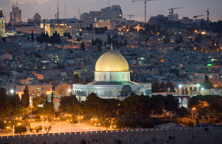 The dome of the rock with the golden roof on the temple mount in the twilight in Jerusalem photo