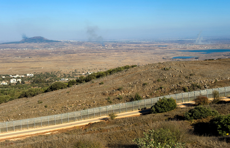 frontline: Explosions from the war in Syria can be seen from a hill on the Golan Heights 150 meter from the border, about 10 kilometers southsouth-east of the city of Al Quneitra, October 04, 2014 in Israel