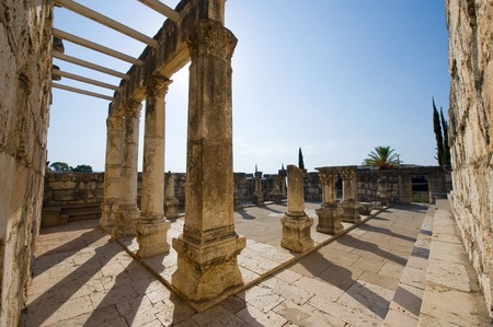 The ruins of the synagoque in the small town Capernaum on the coast of the lake of Galilee.  According to the bible this is the place where Jesus taught photo
