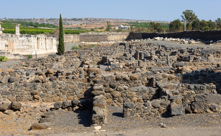 The ruins of houses in the small town Capernaum on the coast of the lake of Galilee.  Left the Synagogue. According to the bible this is the place where Jesus lived and taught