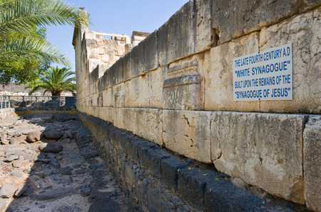 The white stones of the synagogue in Capernaum are built upon the original black remains from the time of Jesus Stock Photo