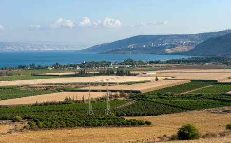 israel agriculture: The west coast of the Lake of Galilee as seen from the north. The city in the middle on the hills is Tiberias.