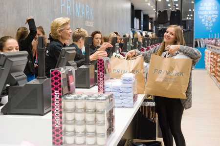 ENSCHEDE, NETHERLANDS -AUG 19, 2014: People are shopping in a new branch of warehouse Primark on the first day at the opening, August 19, 2014 in the Netherlands