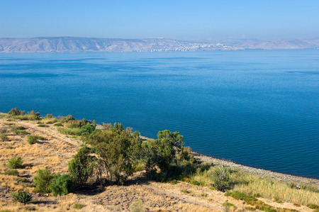 The sea of Galilee in Israel as seen from the east coast, the city on the other side is Tiberias