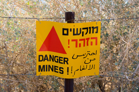 landmine: A warning sign with