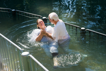 baptismal: YARDENIT, ISRAEL - OCTOBER 05, 2014: A woman is being baptized at the baptismal site Yardenit on the Jordan river, October 05, 2014 in Israel