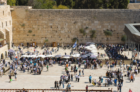 JERUSALEM, ISRAEL - OCT 06, 2014: A lot of tourists and pilgrims on the square in front of the Wailing wall in Jerusalem