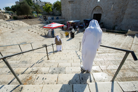 palestinian: JERUSALEM, ISRAEL - OCT 07, 2014: Muslims are walking down the stairs to Damascus gate in the old city of Jerusalem