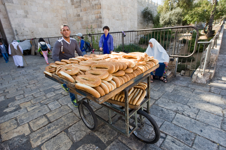 palestinian: JERUSALEM, ISRAEL - OCT 07, 2014: A man with bread on his carrier tricycle near Damascus gate in the old city of Jerusalem Editorial