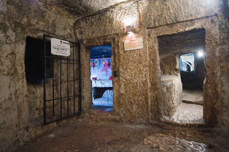 alleged: JERUSALEM, ISRAEL - OCT 07, 2014: Alleged prison where Jesus Christ is said to have been held in the praetorium monastery on the Via Dolorosa in the old city in Jerusalem