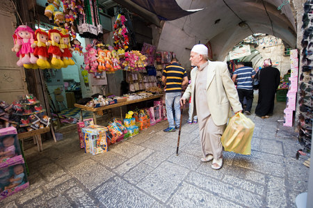 toy shop: JERUSALEM, ISRAEL - OCTOBER 07, 2014: People are walking in one of the small streets in the old city of Jerusalem