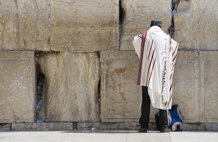 talmud: JERUSALEM, ISRAEL - OCT 07, 2014: A jewish man is praying in front of the western wall in the old city of Jerusalem