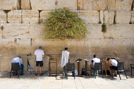 western wall: JERUSALEM, ISRAEL - OCT 07, 2014: Jewish men are praying in front of the western wall in the old city of Jerusalem Editorial