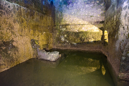 cistern: JERUSALEM, ISRAEL - OCT 07, 2014: The Struthion Pool is a large underground cuboid cistern beneath the Convent of the Sisters of Zion in the Old City of Jerusalem Editorial