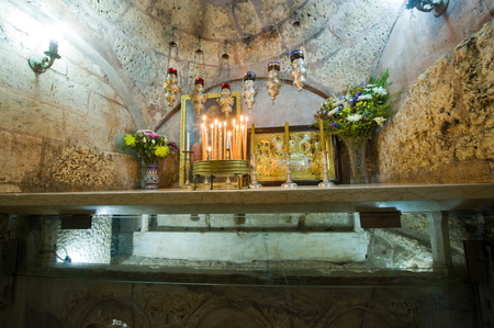 mother to be: JERUSALEM, ISRAEL - 09 OCT, 2014: The sarcophagus of the The Tomb of the Virgin Mary, the mother of Jesus can be seen through glass Editorial