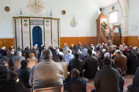 imam: ENSCHEDE, THE NETHERLANDS - FEB 13, 2015: Muslims have gathered for the friday afternoon prayer in a mosque and are listening to the speech of an imam